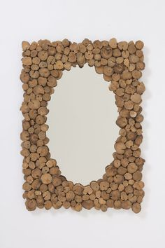 Wood Slice Mirror.   This is a great DIY project for the entire family.