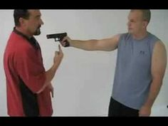 """Self-defense"" upon lethal use of force: how-to disarm a gunman pointing at you in very close proximity."