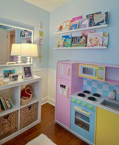 Little Girl Wall Book Display. http://www.myfavoriteeverything.com/2012/home-garden/home-garden-tiny-oranges-design-reveal/#