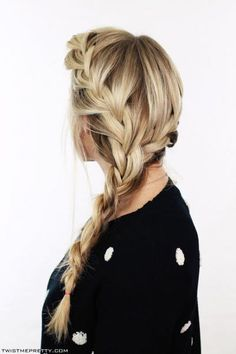 Don't worry! This casual braid is easier than it looks. Just loosely French-braid around both sides of your head, and unite the two braids at the nape of your neck. #Hairstyles #FrenchBraid