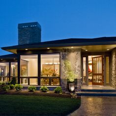 Mid Century Front Porch Design Idea- lights in the stone wall idea looks good!.. near the column base or the green patch..