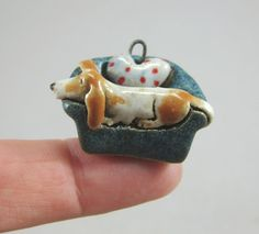 Custom beagle sculpture (70e) and pendant (28e) in stoneware. Both stamped and signed (Sz) on the bottom. Shipping fee is for registered first class flat rate .