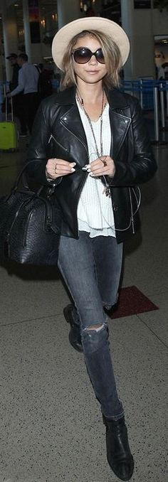 Who made Sarah Hyland's black handbag, leather jacket, and gray skinny jeans?