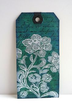 Techniques from Day 7 & 8.   The background is the Rusted Enamel Technique in Evergreen Bough and Faded Jeans. I did quite a few tags using this technque but this is by far my fave colour combo. The script was stamped ontop with Archival Black and the flowers stamped with Paint Dabber in Pearl.