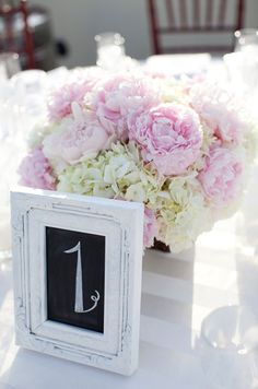 This centerpiece of peonies is both whimsical and romantic. #weddingcenterpiece #weddingflowers