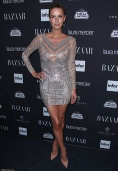 Amazing: Nicky Hilton shimmered in a silver frock that she paired with nude pointed heels and slick tresses