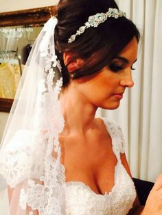 Amazing emerald crown and lace veil. Lethicia Bronstein.