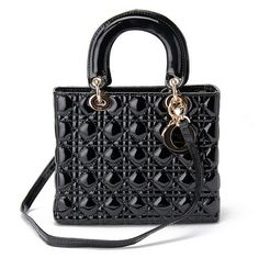 The medium Lady Dior bag in black patent leather with gold hardware