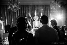 Three tiered wedding cake at a wedding in Paris, France by Wedding Photographer Paul Rogers
