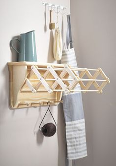 Our wall mounted extending clothes airer dryer located within the utility room. Laundry is hung over the wooden battens allowing it to dry quickly.