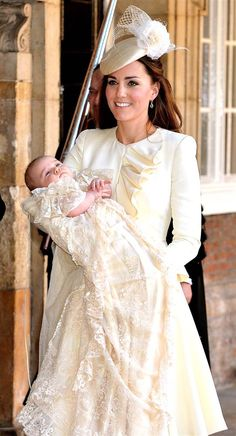 Kate Duchess of Cambridge carries her son Prince George after his christening at the Chapel Royal in St James's Palace in London, Wednesday ...