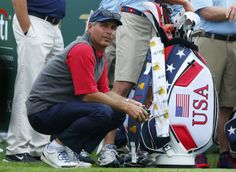 U.S. Team captain Fred Couples kneels during the second practice round for the 2013 Presidents Cup golf tournament at Muirfield Village Golf Club in Dublin, Ohio October 2, 2013. REUTERS/Jeff Haynes