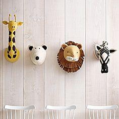 Wall-mounted giraffe, polar bear, lion and zebra.