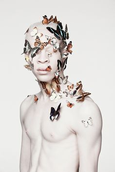 """Photographer Justin Dingwall (previously) continues to challenge how the public perceives and defines beauty. In his photo series """"Albus,"""" butterflies and snakes rest on models with albinism as … Modelo Albino, Lion Noir, Blog Art, Portrait Photography, Fashion Photography, Feminism Photography, Flying Photography, Gothic Photography, Modeling Photography"""