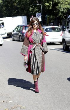 A blanket coat with fuchsia accents.
