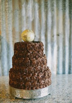 Texas Ranch wedding chocolate groom cake with globe   photo by Amber Vickery Photography   100 Layer Cake