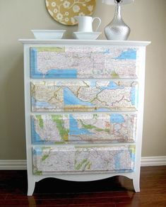 Don't like this dresser but I do like the idea of mod podging maps onto old furniture. They should have gone for a more old world or distressed look