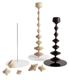 Les Perles Candlestick  Designed by FX Balléry    Each wooden shape is an individual piece – like a bead – that can be rearranged on the stem to create different compositions.  Each Les Perles Candlestick is sold separately.