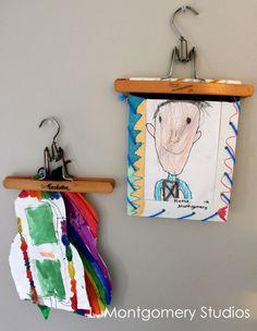 Using vintage pant hangers to display kids artwork. montydob.blogspot.com