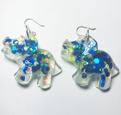 Stand out from the crowd with handcrafted dinosaur earrings on Sterling Silver earring hooks Dinosaur Earrings, Crowd, Hooks, Beading, Jewelry Design, Handmade Items, Glitter, Jewels, Jewellery