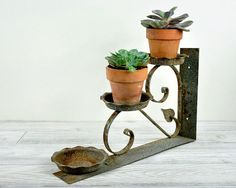 How sweet is this!  Vintage Wrought Iron Plant Holder Wall Bracket / by havenvintage, $32.00