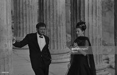 Actor Richard Harris and Princess Soraya of Iran, filming next to ancient ruins, 1964.
