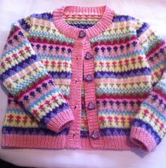 Ravelry: Petite Fleur Fair Isle Cardigan pattern by Audrey Wilson Designed to fit ages: years, years, years. This Pin was discovered by Ruk Intarsia baby button up sweater Discover recipes, home ideas, style inspiration and other ideas to try. Baby Cardigan Knitting Pattern Free, Baby Sweater Patterns, Fair Isle Knitting Patterns, Knitted Baby Cardigan, Knit Baby Sweaters, Cardigan Pattern, Baby Jumper, Knitting Sweaters, Toddler Cardigan