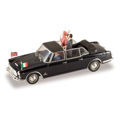 Queen Elizabeth II State Visit Diecast Model.  Queen Elizabeth II has traveled to over 24 countries during her reign. This diecast model car depicts the Queen with President Gronchi during her visit to Italy in 1961. When the Queen announced her visit, Gronchi commissioned car design firm Pininfarina to deliver four Lancia Flaminia stretch limousines to appropriately service the visit (and also to renew the dated presidential fleet).