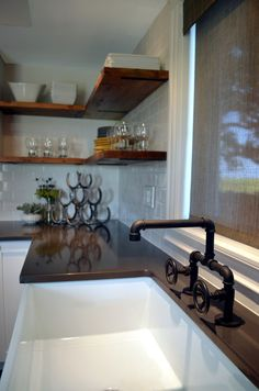 Industrial Farmhouse Kitchen Interior Design, unique industrial faucet, oil rubbed bronze. Designed by VARA Design.