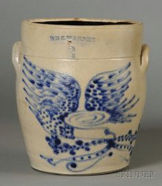 """Stoneware Crock with Cobalt Blue Eagle, """"WM E. WARNER WEST TROY"""", New York, mid-19th century, three-gallon ovoid crock with lug handles, the front decorated with a free-hand spreadwing eagle,"""