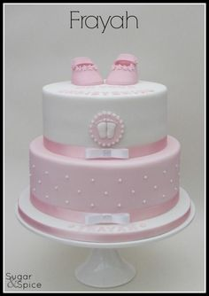 Frayah pink and white christening cake with bootees https://www.facebook.com/SugarandSpiceGourmandise