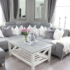 @ small cozy elegant chic classy style apartment couple first home white gray warm colors roses peony flowers silver decoration candle pillows hamptons riviera maison luxury chandelier living room purple dust lavender sofa mirror