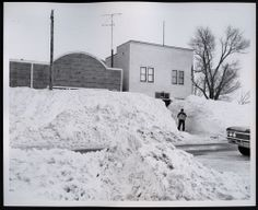 North Dakota Blizzard of 1966;  Hague's main street shows the hardship that the blizzard visited on towns. Snow packs caused by drifts and street clearing appear to be more...