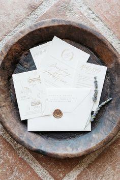 Delicate white and gold invitations: http://www.stylemepretty.com/2015/09/15/italian-destination-wedding-at-castello-di-vicarello/   Photography: Kate Holstein - http://www.kateholstein.com/