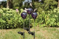 "Set of 3 Mosaic Glass Garden Multicolor Reflections Solar Bug Stakes 33"" by CC Home Furnishings. $94.99. From the Mosaic Glass Garden CollectionItem #65652Features 3 unique solar powered mosaic glass garden stakes that shines light into glass ball at nightMulticolored pieces of glass are selected and set into the weather resistant mortarVariances in glass color and design are expected in each of these unique itemsSolar paneling located on stake well below glas..."