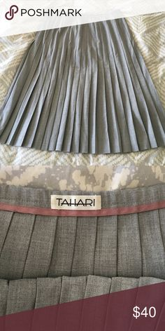 """Vintage Tahari skirt Beautiful midi pleated grey Tahari skirt.  Side zip.  It was already vintage when I bought it about 12 years ago.  Super high quality construction and in pristine condition.  25"""" long, 15"""" across the waistband flat. Tahari Skirts Midi"""