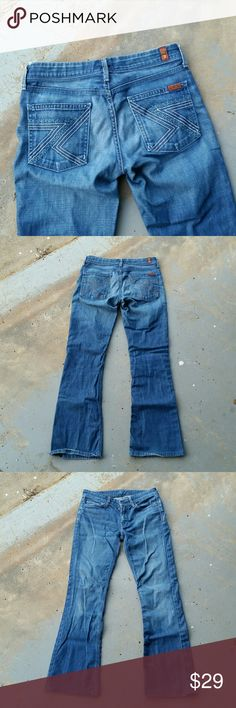 """7 FOR ALL MANKIND DISTRESSED BOOTCUT JEANS 7 For All Mankind distressed bootcut jeans. Made in USA. 98% cotton. 2% lycra. 27"""" waist. 7.5"""" rise. 30"""" inseam. 9"""" ankle opening. 7 For All Mankind Jeans Boot Cut"""