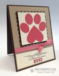 """The paw print is simple punch art. The """"toes"""" were cropped with the Stampin' Up! Small Oval Punch and the """"base"""" is the Full Heart Punch."""