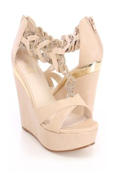 You will be head over heels for these saucy little numbers! They will perfectly compliment any outfit for any occasion! Make sure to add these to your collection, they definitely are a must have! The features for these wedges include a smooth faux leather upper, open toe, cut out T-strap detailing, rhinestone studded decor, back zip up closure, complete with a smooth lining, and cushioned footbed. Approximately 5 inch wedges and 1 1/2 inch platforms.