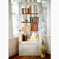 Old door turned into a bookcase  - 11 Great Ideas for Repurposed Doors