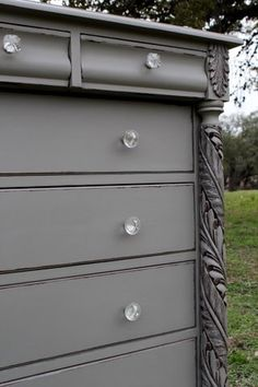 Annie Sloan Chalk Paint - Vintage chest of drawers painted with French Linen.  That carving!!!