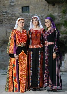 Traditional Palestinian embroidered 'thobe' (ankle-length garment, sometimes with long sleeves). Dance Dresses, Girls Dresses, Costumes Around The World, Palestinian Embroidery, Ethnic Outfits, Folk Costume, World Cultures, Ethnic Fashion, Traditional Dresses