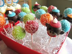 Cake pops!  love the bright color with white sprinkles :)  the sock monkeys, not so much...