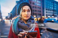 Stock Photo : Woman using mobile phone in a street.