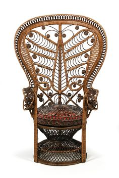 Large cane chair, England 20th century. Made in bamboo with basket weave, of a splayed form with a later seat cushion. Height ca. 140 cm