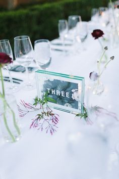 acrylic wedding table numbers / http://www.himisspuff.com/acrylic-and-lucite-wedding-decor-ideas/3/