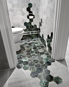Amazing bathroom tile! I love the seamless integration as it creeps up the walls and out the door, plus the unique hexagon shape is beautiful.
