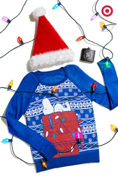 A graphic Snoopy sweater, Santa hat and a flask: fun things that will get any Christmas party started.