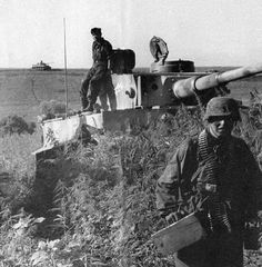 A German Tiger 1 tank and supporting infantry.