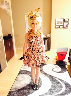 Most popular tags for this image include: effie trinket, butterfly dress, costume, Halloween and halloween costume